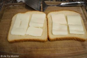 Add the butter to the inside of the bread slices.