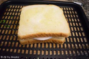 Place the sandwich on the air fryer tray or in the basket.