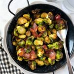 Air fryer brussels sprouts with bacon in a serving dish.